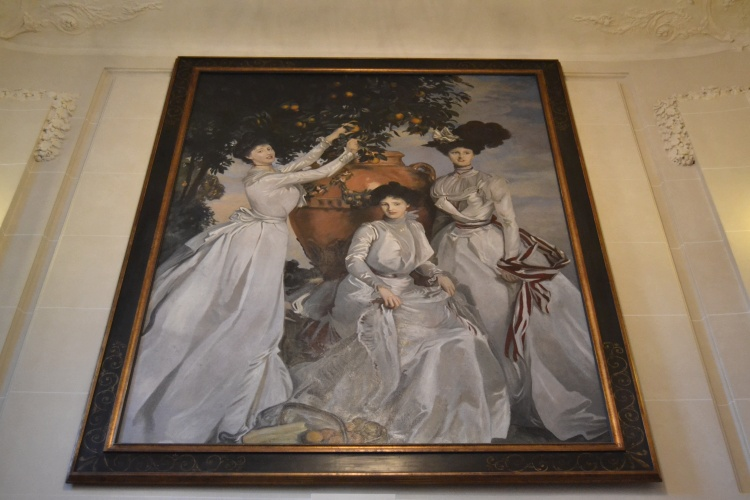 A large painting in the breakfast room