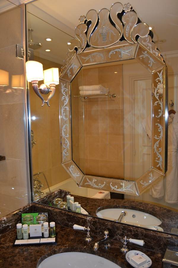 The marble bathroom with Venetian mirror