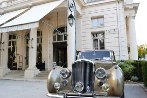 Hotel entrance with a Bentley