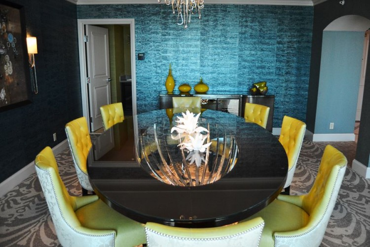 Dining room with kitchen in background