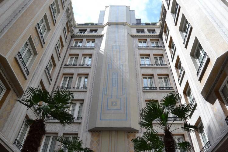 Art Deco façade overhanging Le Patio