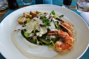 Caesar salad with grilled prawns