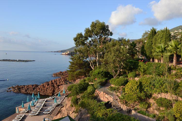 Mediterranean garden lining the sea