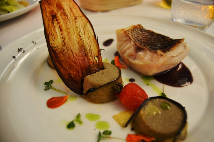 Meager, cooked in olive oil, with tangy wine sauce and Istanbul style burnt eggplant flan