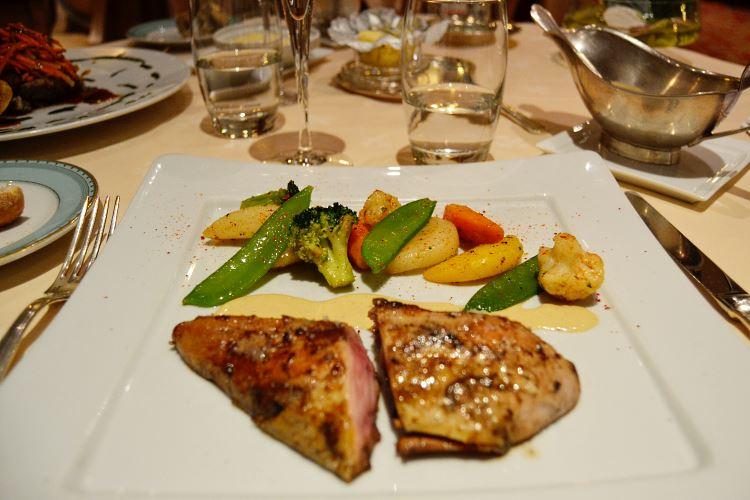 "Pheasant hen breast cooked in ""low temperature"", smoked with hay, sauce poulette with yellow wine and vegetables from the garden"