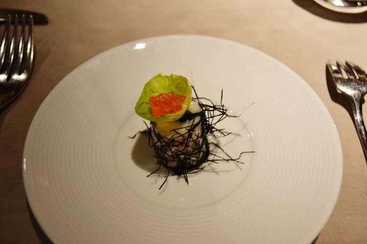 Fine amuse-bouche : topped with salmon eggs cod