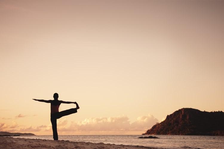 Raffles Praslin - Yoga on the beach